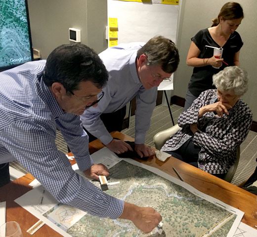 Family members reviewing property map of the Shield Ranch.